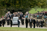 """Prince Charles, Prince of Wales and Camilla, The Duchess of Cornwall and the Duke of Devonshire follow the funeral cortege of Deborah, Dowager Duchess of Devonshire as it makes it's way to St Peters Church, Edensor, from Chatsworth House on October 2, 2014 in Chatsworth, England. Deborah Cavendish, Dowager Duchess Of Devonshire, the last surviving Mitford sister, died aged 94 on September 24, 2014. Deborah was known as the """"housewife duchess"""", and her noted business acumen made Chatsworth House one of the most successful and profitable stately homes in England."""