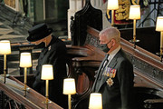 Queen Elizabeth II and Prince Andrew, Duke of York attend the funeral of Prince Philip, Duke of Edinburgh at Windsor Castle on April 17, 2021 in Windsor, England. Prince Philip of Greece and Denmark was born 10 June 1921, in Greece. He served in the British Royal Navy and fought in WWII. He married the then Princess Elizabeth on 20 November 1947 and was created Duke of Edinburgh, Earl of Merioneth, and Baron Greenwich by King VI. He served as Prince Consort to Queen Elizabeth II until his death on April 9 2021, months short of his 100th birthday. His funeral takes place today at Windsor Castle with only 30 guests invited due to Coronavirus pandemic restrictions.