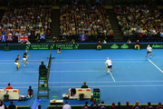 Jamie Murray and Dominic Inglo of the Aegon GB Davis Cup Team in action against Mike Bryan and Bob Bryan of the United States during the doubles match on Day 2 of the Davis Cup match between GB and USA at the Emirates Arena on March 7, 2015 in Glasgow Scotland.