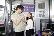 Spencer Sutherland and Madison Iseman arrive at GBK Pre Oscar Gift Lounge at Kimpton La Peer Hotel on February 07, 2020 in West Hollywood, California.