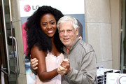 Actors Teyonah Parris (L) and Robert Morse attend the GBK Productions Luxury Lounge honoring the best in TV held at LErmitage on August 23, 2014 in Beverly Hills, California.