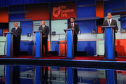 Republican presidential candidates (L-R) Jim Gilmore, Sen. Lindsey Graham (R-SC), Louisiana Gov. Bobby Jindal, Rick Perry and Rick Santorum take their podiums at the beginning of a presidential forum hosted by FOX News and Facebook at the Quicken Loans Arena August 6, 2015 in Cleveland, Ohio. Seven GOP candidates were selected to participate in the forum based on their rank in an average of the five most recent national political polls.
