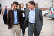 Louisiana Gov. Bobby Jindal (L) and Republican presidential candidate and Texas Gov. Rick Perry walk together after a campaign meet and greet at The Button Factory restaurant on December 21, 2011 in Muscatine, Iowa. Perry is on a bus tour across Iowa to campaign before the caucuses.