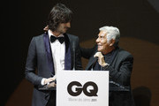 Roberto Cavalli (R) speaks as his son Daniele Cavalli (L) gestures during the GQ Man of the Year Award 2011 at Komische Oper on October 28, 2011 in Berlin, Germany.