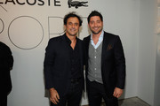 President and CEO of Lacoste North America Francis Pierrel (L) and professional baseball player Francisco Cervelli attend GQ X Lacoste Celebrate Sport pop-up shop opening in NYC hosted by Paul Wesley on October 23, 2014 in New York City.