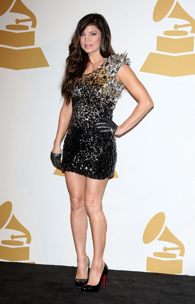 Singer Fergie poses in the press room during The GRAMMY Nominations Concert Live! at the Club Nokia on December 2, 2009 in Los Angeles, California.