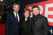 British Consul General Michael Howells (L), Lorraine Ashbourne and actor Andy Serkis (R) attends the Great British Film Reception honoring the British nominees of The 90th Annual Academy Awards on March 2, 2018 in Los Angeles, California.