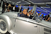 Rev Run and Nick Cannon attend the gala opening of the new Merceses-Benz Manhattan at Mercedes-Benz Manhattan on June 21, 2011 in New York City.