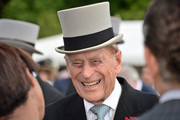 Prince Philip, Duke of Edinburgh smiles as he speaks with guest at a garden party at Buckingham Palace on June 1, 2017in London, England.