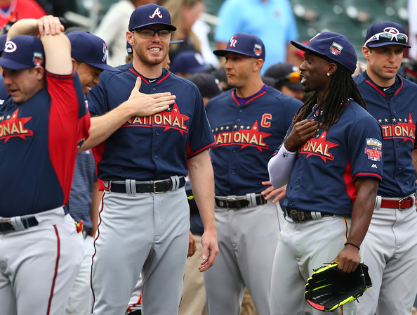 Andrew McCutchen of the Pittsburgh Pirates speaks with Freddie Freeman of the Atlanta Braves during the Gatorade All-Star Workout Day at Target Field on July 14, 2014 in Minneapolis, Minnesota. (July 13, 2014 - Source: Elsa/Getty Images North America)