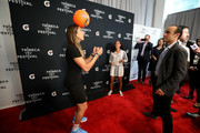 "(L-R) Melissa Ortiz, Gisela Robledo Gil and Landon Donovan dribble a soccer ball at the Gatorade premiere of the docu-series, ""Cantera 5v5"" during the Tribeca TV Festival on Saturday, September 14, 2019 in New York City."