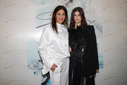 (L-R) Sara Cavazza Facchini and Alexandra Daddario attend the runway at the Genny show at Milan Fashion Week Autumn/Winter 2019/20 on February 21, 2019 in Milan, Italy.