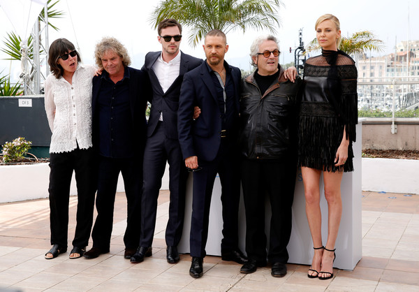 'Mad Max: Fury Road' Photocall - The 68th Annual Cannes Film Festival [mad max: fury road,social group,fashion,event,team,suit,white-collar worker,formal wear,little black dress,fashion design,george miller,nicholas hoult,tom hardy,doug mitchell,charlize theron,photocall,photocall,l-r,cannes film festival]