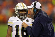 (L-R) TaQuon Marshall #16 talks to his head coach Paul Johnson of the Georgia Tech Yellow Jackets during their game against the Clemson Tigers at Memorial Stadium on October 28, 2017 in Clemson, South Carolina.