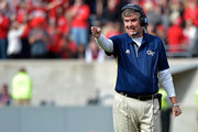 Head coach Paul Johnson of the Georgia Tech Yellow Jackets  directs his team against the North Carolina State Wolfpack during their game at Carter-Finley Stadium on November 8, 2014 in Raleigh, North Carolina.