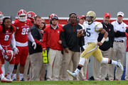 Justin Thomas #5 of the Georgia Tech Yellow Jackets breaks free along the sideline during their game against the North Carolina State Wolfpack at Carter-Finley Stadium on November 8, 2014 in Raleigh, North Carolina. Georgia Tech won 56-23.