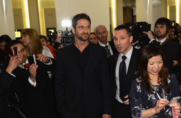Gerard Butler - Roger Dubuis Booth At The 23rd Salon International De La Haute Horlogerie: Day 1