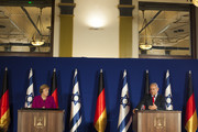 (ISRAEL OUT) Israeli Prime Minister Benjamin Netanyahu (R) and German Chancellor Angela Merkel give a joint press conferenceon on October 4, 2018 in Jerusalem, Israel. Merkel spoke of Germany's 'everlasting responsibility' to oppose anti-Semitism during a visit to Israel, as she and Netanyahu brushed past their differences and promoted cooperation between their nations.
