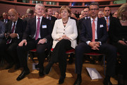 German Chancellor Angela Merkel (C) sits next to  ThyssenKrupp Chairman Heinrich Hiesinger (L) and BDI President Ulrich Grillo at the annual congress of the German Federation of Industry (BDI) on September 23, 2014 in Berlin, Germany. The BDI is the biggest umbrella organization of German manufacturers.
