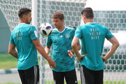Sami Khedira of Germany speaks to Thomas Mueller of Germany and Mario Gomez of Germany during the Germany training session ahead of the 2018 FIFA World Cup at CSKA Sports Base on June 14, 2018 in Moscow, Russia.