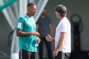 Joachim Loew, head coach  of Germany talks to his player Jerome Boateng during the Germany Training Session at ZSKA Vatutinki Sportarena on June 25, 2018 in Moscow, Russia.