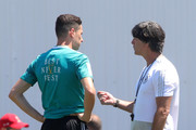 Head coach Joachim Loew (R) talks to Julian Draxler during a Germany training session during the 2018 FIFA World Cup at Park Arena Training Ground on June 20, 2018 in Sochi, Russia.
