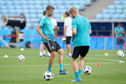 Thomas Mueller of Germany plays the ball with his team mate Timo Werner (R) during the Germany Training & Press Conference at Fisht Stadium on June 22, 2018 in Sochi, Russia.