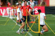 Thomas Mueller (L) of Germany in action with team mate Mesut Oezil during the German national team training session at Campo Bahia on July 10, 2014 in Santo Andre, Brazil.