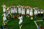 Sami Khedira of Germany hold the World Cup trophy and celebrates with teammates after defeating Argentina 1-0 in extra time during the 2014 FIFA World Cup Brazil Final match between Germany and Argentina at Maracana on July 13, 2014 in Rio de Janeiro, Brazil.