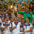 Bastian Schweinsteiger Andre Schuerrle Photos - Bastian Schweinsteiger of Germany lifts the World Cup trophy with teammates after defeating Argentina 1-0 in extra time during the 2014 FIFA World Cup Brazil Final match between Germany and Argentina at Maracana on July 13, 2014 in Rio de Janeiro, Brazil. - Germany v Argentina