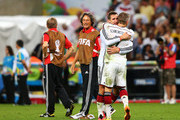 Miroslav Klose and Bastian Schweinsteiger of Germany celebrate after defeating Argentina 1-0 in extra time during the 2014 FIFA World Cup Brazil Final match between Germany and Argentina at Maracana on July 13, 2014 in Rio de Janeiro, Brazil.