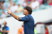 Joachim Loew, coach of Germany gives his team instructions during the FIFA Confederations Cup Russia 2017  Group B match between Germany and Cameroon at Fisht Olympic Stadium on June 25, 2017 in Sochi, Russia.