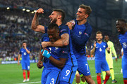 (L to R) Patrice Evra, Olivier Giroud and Antoine Griezmannof France celebrate their team's 2-0 win in the UEFA EURO semi final match between Germany and France at Stade Velodrome on July 7, 2016 in Marseille, France.