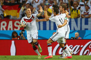 Miroslav Klose of Germany (R) celebrates scoring his team's second goal with Bastian Schweinsteiger (L) and Thomas Mueller during the 2014 FIFA World Cup Brazil Group G match between Germany and Ghana at Castelao on June 21, 2014 in Fortaleza, Brazil.