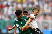 Thomas Mueller of Germany is tackled by Carlos Vela of Mexico during the 2018 FIFA World Cup Russia group F match between Germany and Mexico at Luzhniki Stadium on June 17, 2018 in Moscow, Russia.