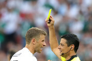 Thomas Mueller of Germany is shown a yellow card by Referee Cesar Ramos during the 2018 FIFA World Cup Russia group F match between Germany and Mexico at Luzhniki Stadium on June 17, 2018 in Moscow, Russia.