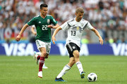 Thomas Mueller of Germany runs with the ball under pressure from Hirving Lozano of Mexico during the 2018 FIFA World Cup Russia group F match between Germany and Mexico at Luzhniki Stadium on June 17, 2018 in Moscow, Russia.
