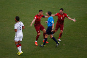 Cristiano Ronaldo (2nd L) and Joao Moutinho (R) of Portugal react toward referee Milorad Mazic during the 2014 FIFA World Cup Brazil Group G match between Germany and Portugal at Arena Fonte Nova on June 16, 2014 in Salvador, Brazil.