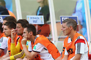 Miroslav Klose of Germany (center) and Bastian Schweinsteiger (left) looks on from the bench during the 2014 FIFA World Cup Brazil Group G match between Germany and Portugal at Arena Fonte Nova on June 16, 2014 in Salvador, Brazil.