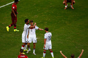 Thomas Mueller of Germany celebrates with teammates Sami Khedira and Mario Goetze after scoring his team's third goal during the 2014 FIFA World Cup Brazil Group G match between Germany and Portugal at Arena Fonte Nova on June 16, 2014 in Salvador, Brazil.