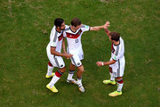 Thomas Mueller of Germany celebrates scoring his team's third goal with teammates Sami Khedira and Mario Goetze during the 2014 FIFA World Cup Brazil Group G match between Germany and Portugal at Arena Fonte Nova on June 16, 2014 in Salvador, Brazil.