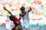 Eder of Portugal is challenged by Sami Khedira of Germany during the 2014 FIFA World Cup Brazil Group G match between Germany and Portugal at Arena Fonte Nova on June 16, 2014 in Salvador, Brazil.