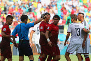Pepe of Portugal (3rd R) reacts after receiving a red card by referee Milorad Mazic during the 2014 FIFA World Cup Brazil Group G match between Germany and Portugal at Arena Fonte Nova on June 16, 2014 in Salvador, Brazil.