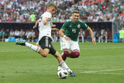 Thomas Mueller of Germany battles for the ball with Hector Herrera of Mexico  during the 2018 FIFA World Cup Russia group F match between Germany and Mexico at Luzhniki Stadium on June 17, 2018 in Moscow, Russia.
