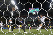 Robin Olsen of Sweden saves from Mario Gomez of Germany during the 2018 FIFA World Cup Russia group F match between Germany and Sweden at Fisht Stadium on June 23, 2018 in Sochi, Russia.