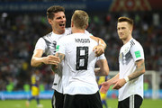 Toni Kroos of Germany celebrates with Mario Gomez (l) and Marco Reus after scoring his sides winning goal during the 2018 FIFA World Cup Russia group F match between Germany and Sweden at Fisht Stadium on June 23, 2018 in Sochi, Russia.