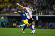 Emil Forsberg of Sweden is tackled by Thomas Mueller of Germany  during the 2018 FIFA World Cup Russia group F match between Germany and Sweden at Fisht Stadium on June 23, 2018 in Sochi, Russia.