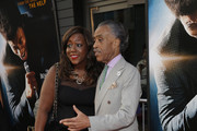 """Rev. Al Sharpton and a guest attend the """"Get On Up"""" premiere at The Apollo Theater on July 21, 2014 in New York City."""
