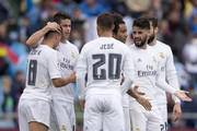 James Rodriguez (2ndL) of Real Madrid CF celebrates scoring their fourth goal with teammates Lucas Vazquez (L), Jese Rodriguez (3dL), Marcelo (3dR), Francisco Roman Alarcon alias Isco and Nacho Fernandez (R) during the La Liga match between Getafe CF and Real Madrid CF at Coliseum Alfonso Perez on April 16, 2016 in Getafe, Spain.