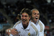 Sergio Ramos (L) and Pepe of Real Madrid celebrate after Ramos scored Real's opening goal against Getafe during the La Liga match between Getafe and Real Madrid at Coliseum Alfonso Perez stadium on February 4, 2012 in Getafe, Spain.